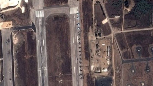 Russian fighter jets and helicopters at a military base in the government-controlled coastal Syrian city of Latakia