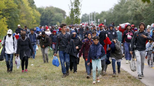 Migrants walk through Hungary