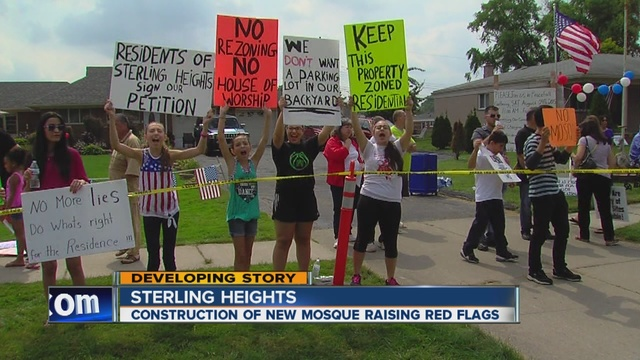 Residents_in_Sterling_Heights_are_raisin_3359640001_23399073_ver1.0_640_480